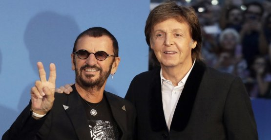 Paul McCartney and Ringo Starr together to sing Lennon: and there is also Harrison...