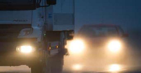 With the car safely through the autumn mist