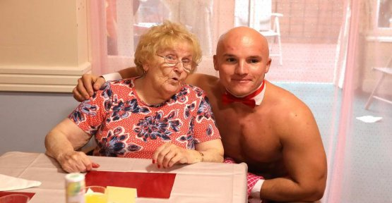 Fun in the nursing home: a muscle-bound Stripper serving old ladies eating