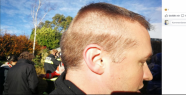 A firefighter rushes with semi-finished hairstyle to use